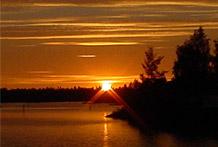 Aurores boréales et soleil de minuit